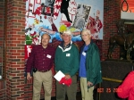Marvin Byrd, Cap Hurlbutt, Jim Sinclair  standing in front of the Great Spirit statue  and one of the theme murals.
